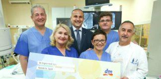 dm - donacija